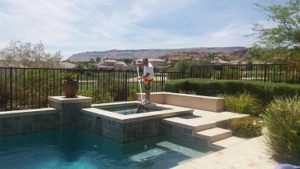 A man providing a weekly residential pool cleaning service in Las Vegas, NV